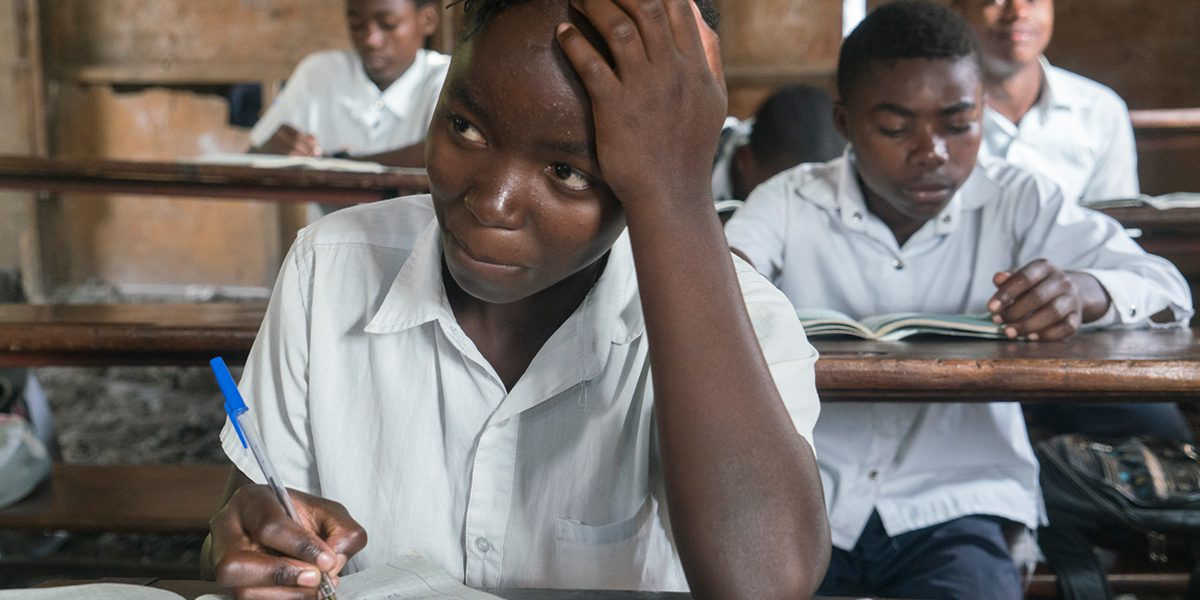 A student participates in math class at a school in Goma built and supported by JRS.