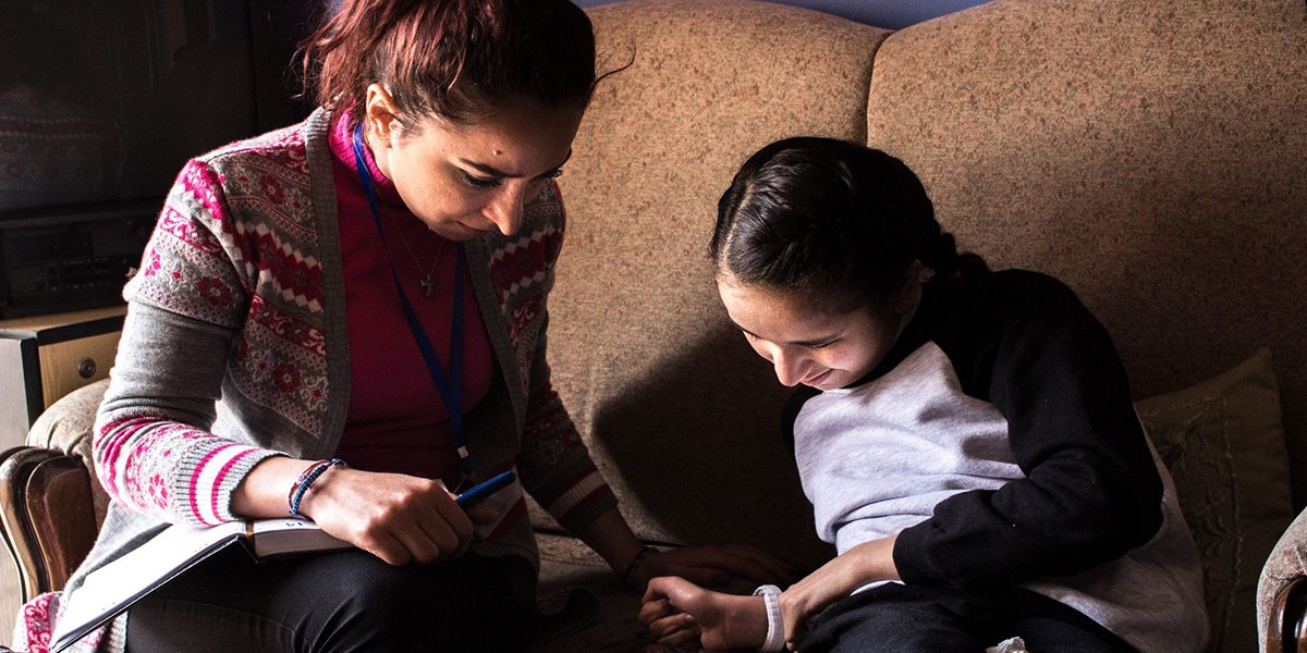 A JRS Syria team member visits Amina, a Syrian girl who has taught herself to read and write after being displaced from the conflict.