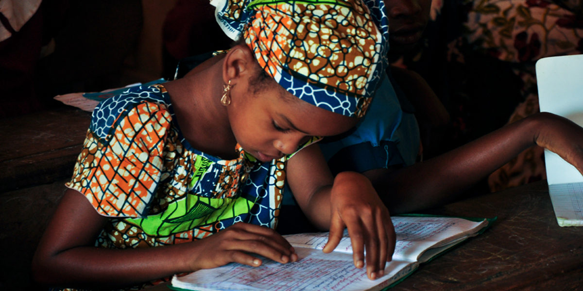 Children learn to write in a newly constructed classroom in Bambari.