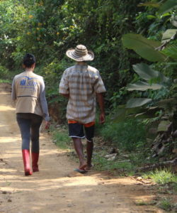 A member of the JRS LAC team walks with a beneficiary
