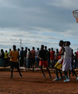 Refugees play basketball in the Dzaleka refugee camp