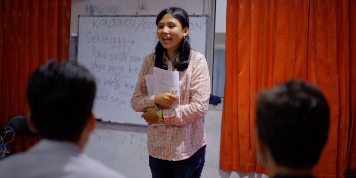 Sari teaches refugees the Indonesia national language to help them integrate in their new communities.