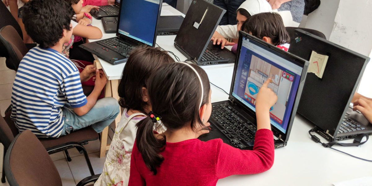 Children attend computer classes run by JRS Greece.