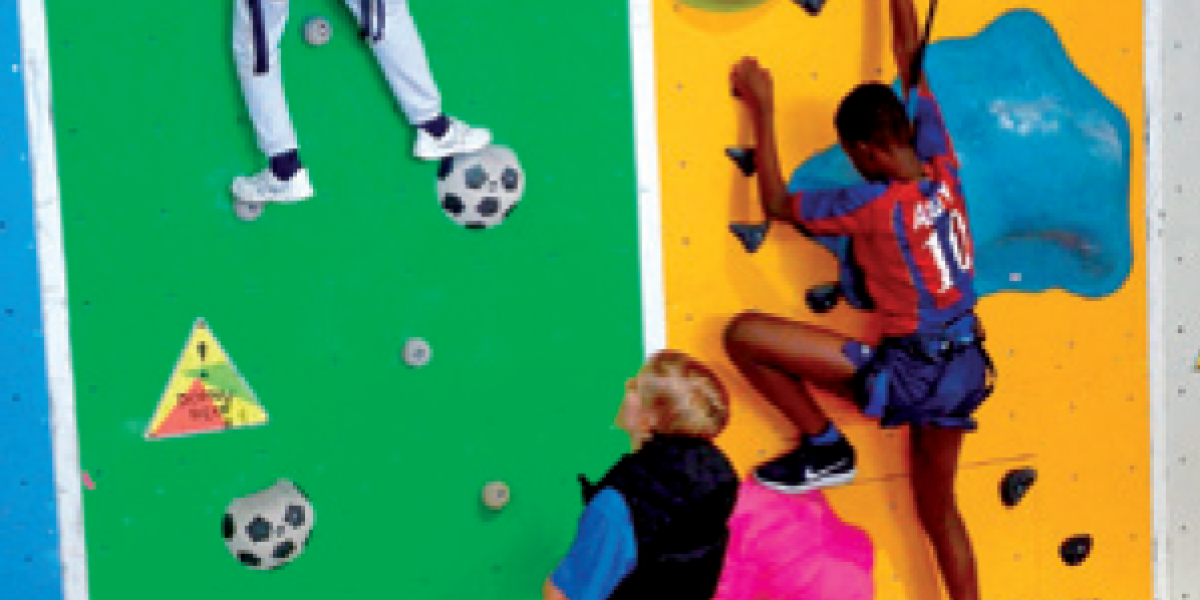 Children take part in an indoor climbing session organised by W Akcji.