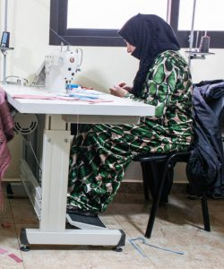 Displaced women attending a sewing class in Lebanon