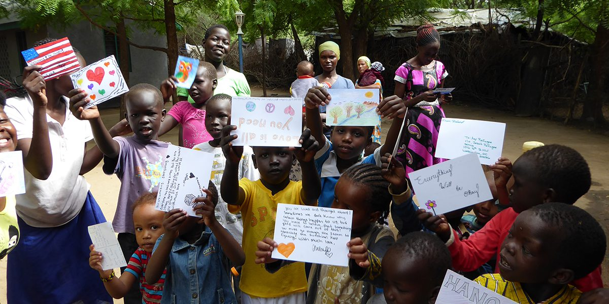 A group of children receive beautiful Any Refugee cards from USA children.