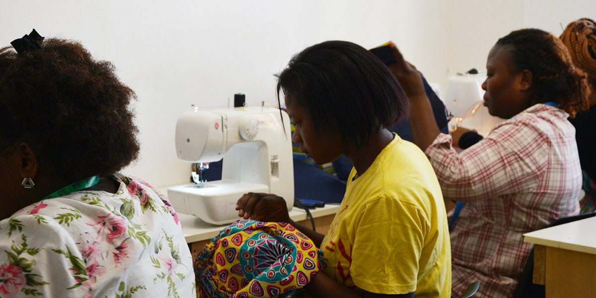 Women sewing clothing and other items at the JRS South Africa's Arrupe Centre.