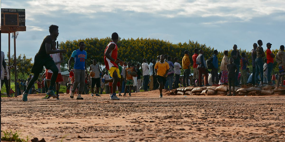 Refugees play basketball at the Dzaleka refugee camp.