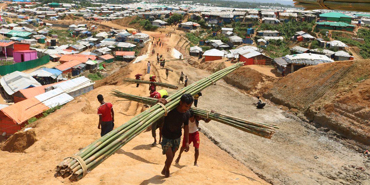 Men carrying building materials