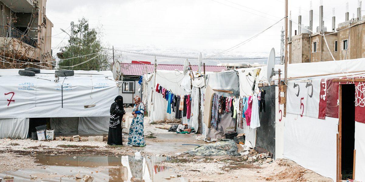 Women talk in a refugee camp near Bar Elias.