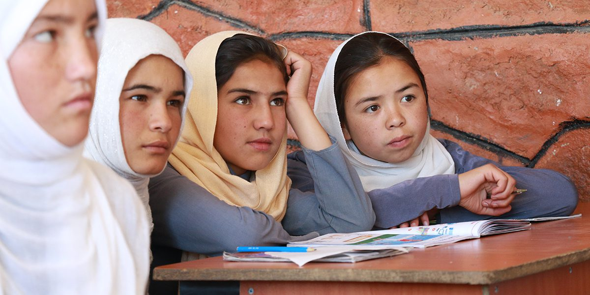 Girls students attending a primary school class.