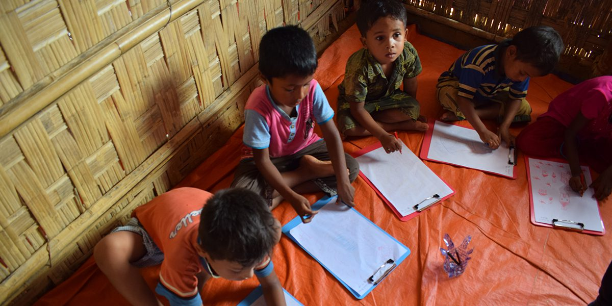 Rohingya children attending the activities of the JRS Child Friendly Spaces