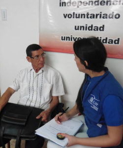 A member of the JRS team assisting beneficiaries