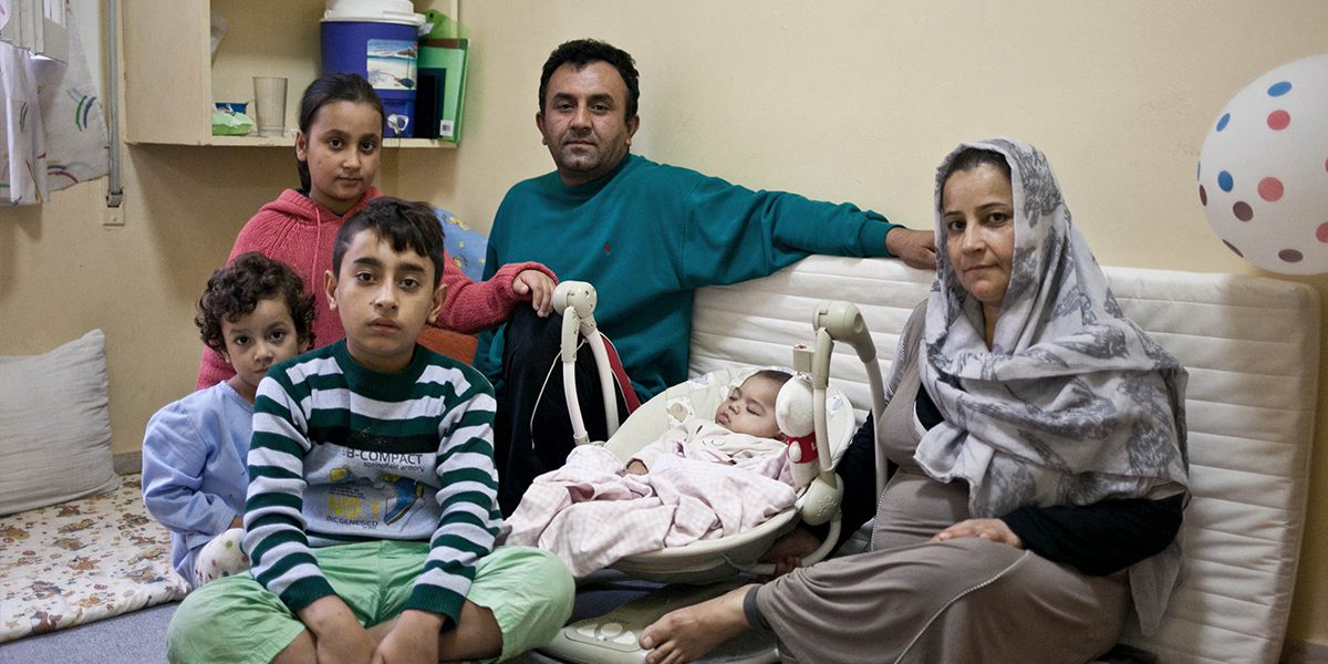 A family who found refuge at the JRS Greece shelter sits together