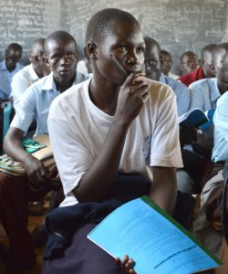 Students attending classes at Pagirinya secondary school for refugees and locals, Adjumani, northern Uganda