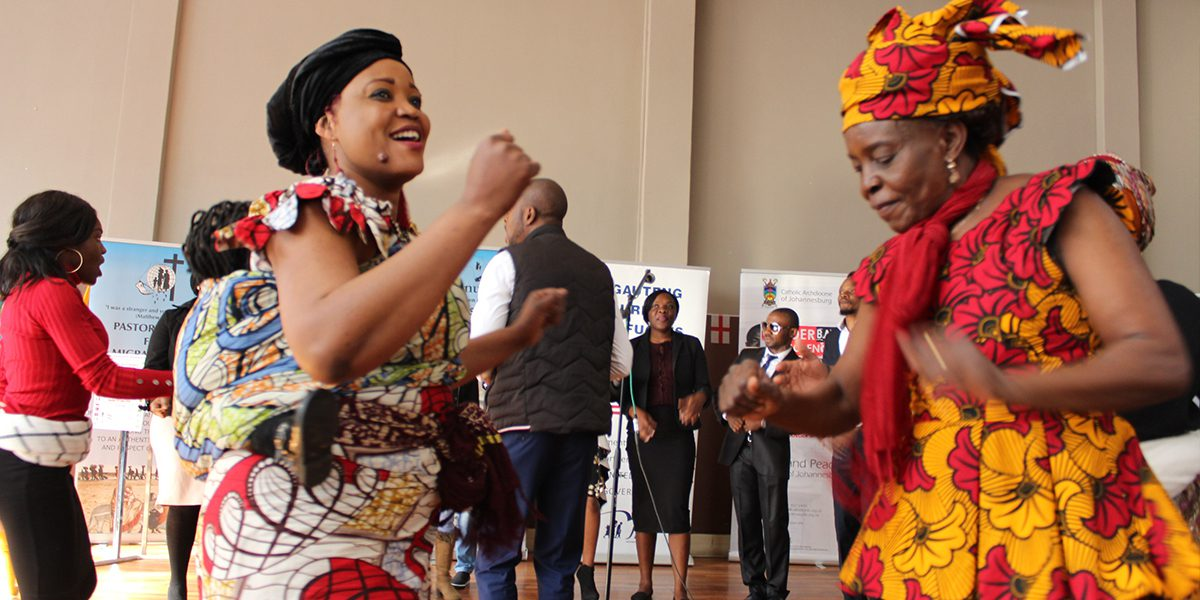 Women dancing at the JRS South Africa World Refugee Day celebration.
