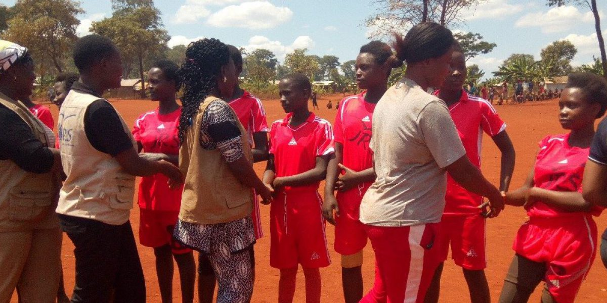 JRS and Plan International staff greeting the girl football teams during World Youth Day. (Jesuit Refugee Service)
